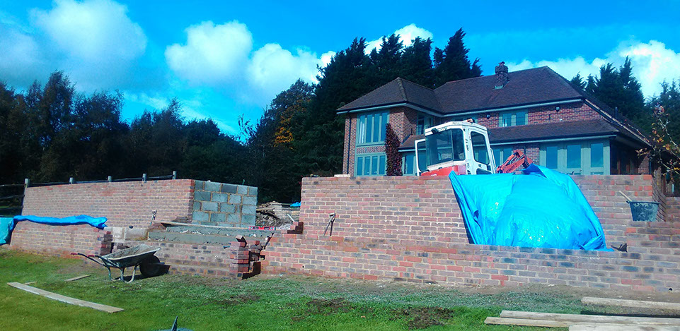 After the concrete blocks have been filled we built brick walls to face. The grand stair case is now being constructed.