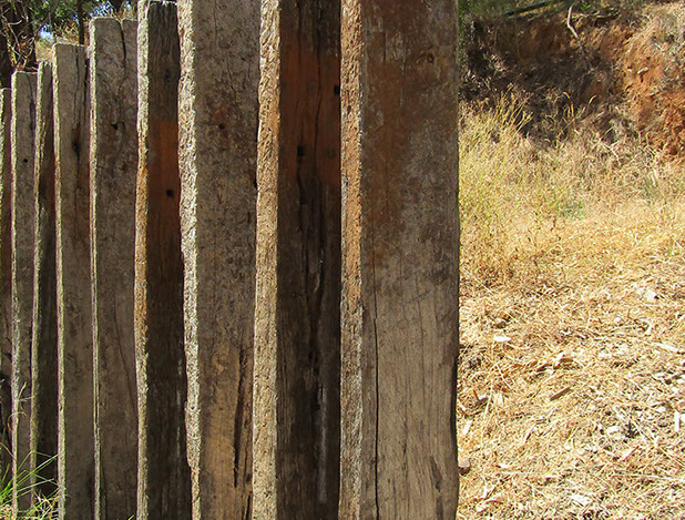 Architectural railway sleepers forming an edge to the walkway