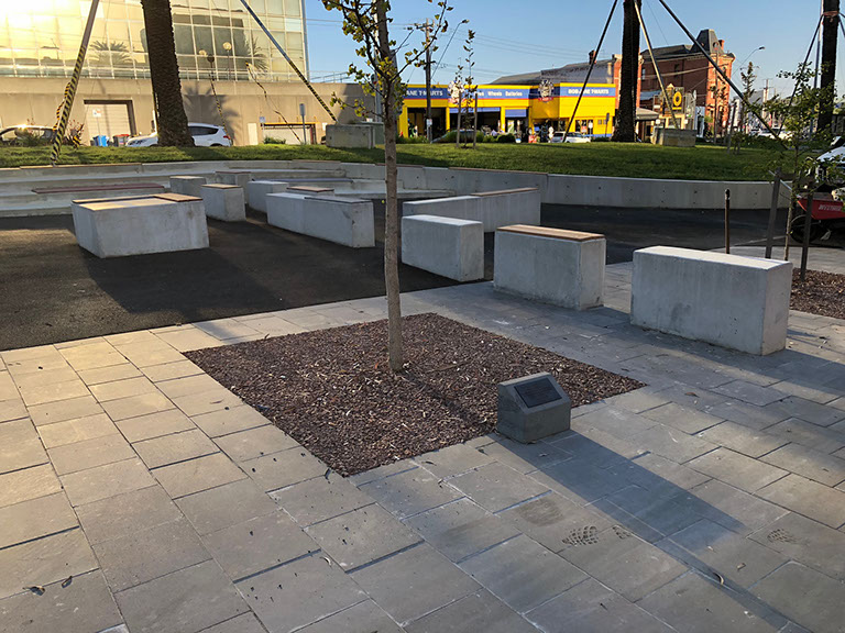 Concrete retaining walls, seating structures with Blue Stone paving