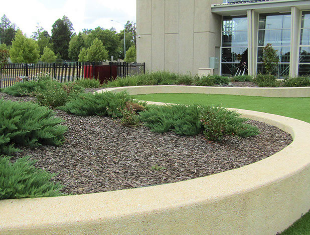 Curved exposed aggregate walls under laid with Astor turf