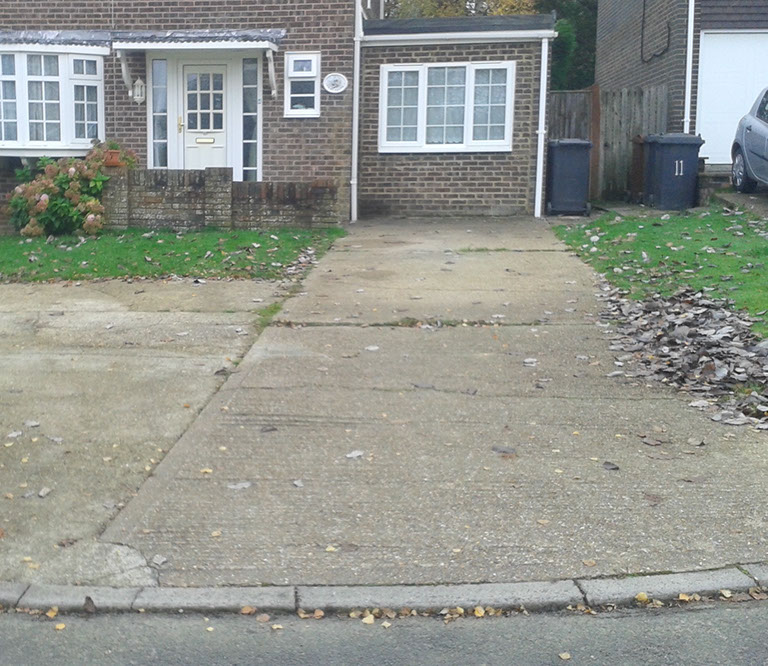 The existing concrete driveway, cracked and dirty